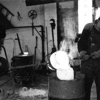 John Miecznikowski and Wallace casting molten bronze