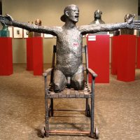 George Wallace - Legless Man on a Chair (second version), 1975, welded steel